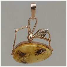 Gold pendant with amber inclusions