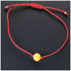 Red string with amber bead